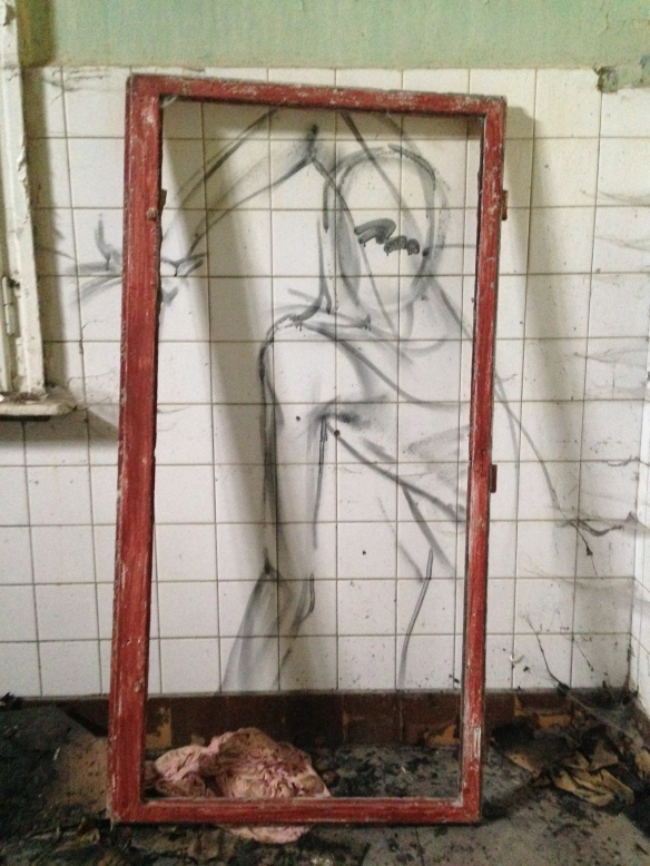 This graffiti seems to be framed by an old window frame