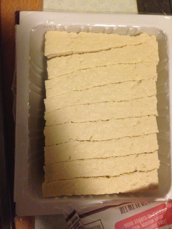 "Slice the tofu into 1/2"" slices in the container"
